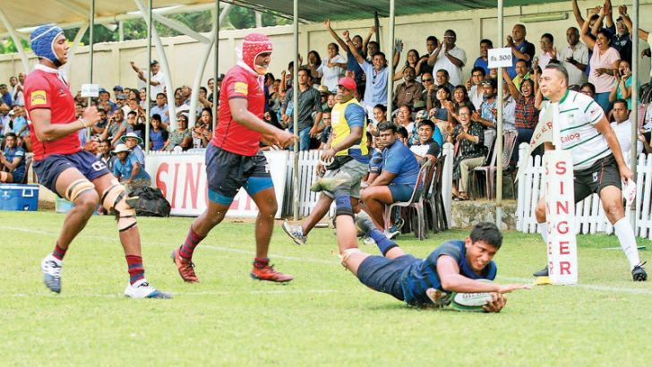 A Thomian attacker touch down for a try score.  Picture by Dushmantha Mayadunne