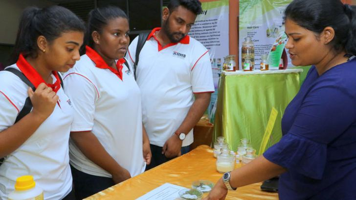 Students of the IIT and the Kalutara College of Education view some of the exhibits on display. Pictures by Saman Sri Wedage.