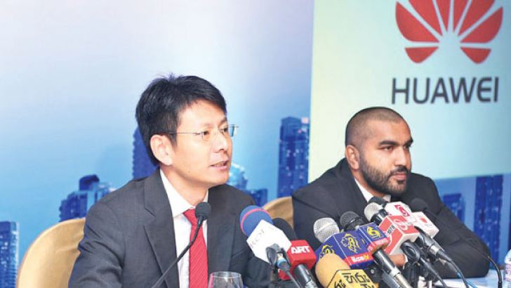 Huawei Technologies Lanka Co. (Pvt) Ltd. Director Public Affairs & Communications Li Qing, Director Enterprise Business Group Sri Lanka Guozhong Xin, CEO Shunli Wang, Public Relations Manager Jithendra Antonio