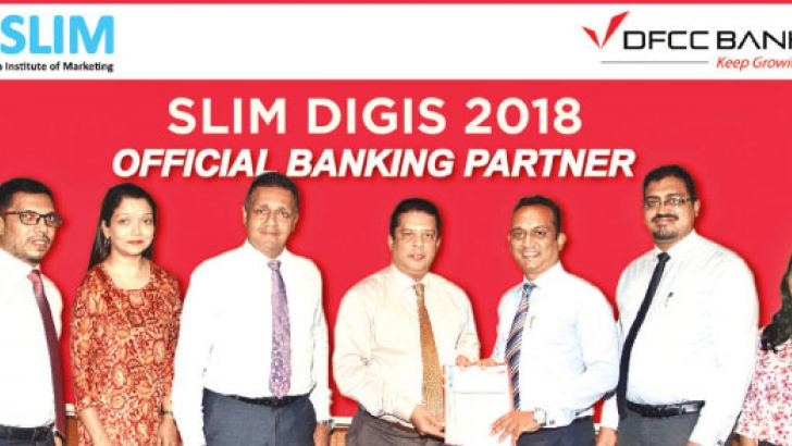 Lakshman Silva (CEO, DFCC Bank) and Pradeep Edward (President,  SLIM) exchanging the MoU. Also in picture (L to R) Dinuka Herath, Assets  & Liabilities Marketing Manager (DFCC), Nilmini Gunaratne, VP,  Marketing (DFCC), Thimal Perera, Deputy Chief Executive Officer (DFCC), Lakshman Silva, Chief Executive Officer, (DFCC), Pradeep Edward, President (SLIM), Dimithra Silva, Assistant  Manager Events (SLIM), Amaya Fernando, Junior Associate, Events (SLIM)