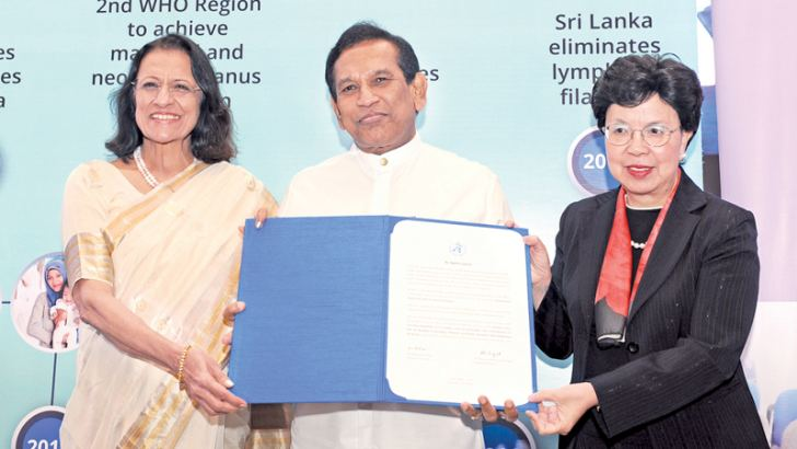 WHO South-East Asia Regional Director Dr. Poonam Khetrapal Singh, Health Minister Dr. Rajitha Senaratne and WHO Director General Dr. Margaret Chan with the Malaria Elimination Certificate awarded to Sri Lanka by the WHO.