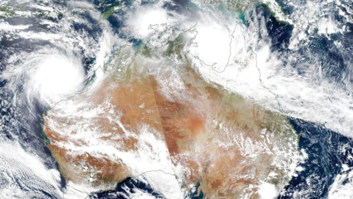 Cyclone Veronica (L) is seen over Western Australia and Cyclone Trevor over Northern Territory (Top, Right) in this satellite image by NASA.