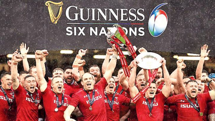 Wales players celebrate winning the 2019 Six Nations, grand slam and triple crown.