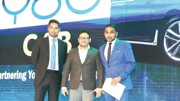 Kumar Sangakkara and Mahela Jayawardene with YOUCAB CEO Thushan Jayaratne