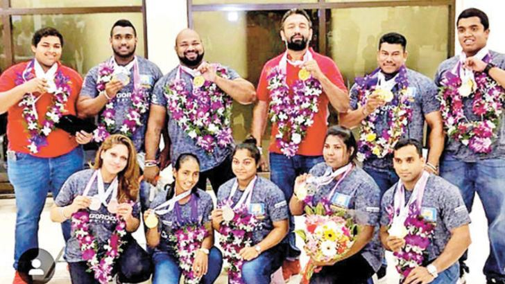The Lankan powerlifting team with their medals on their arrival at the BIA.