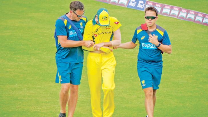 Australian fast bowler Jhye Richardson is helped off the field after dislocating his shoulder during the second ODI against Pakistan at Sharjah on Sunday. – AFP