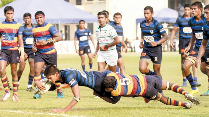 A Thomian attacker (with ball in the hand) touches down for a try. Picture by Dushmantha Mayadunne