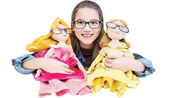 Lowri Moore with her Princesses Belle and Aurora dolls