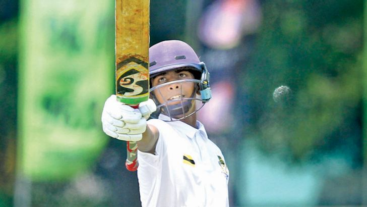 DS Senanayake batsman Shenal Baskaran celebrates his half century on the opening day of the 13th Battle of the Golds cricket match against Mahanama at the P Sara Oval yesterday.