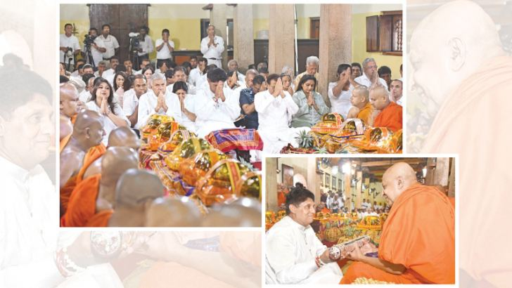 The Mahanayake of the Malwatte Chapter, Most Ven.Thibbotuwawe Sri Siddhartha Sumangala Thera yesterday presented the scroll bestowing the honorary title of 'Sasana Deepana Abhimani Sri Lanka Janaranjana' to Housing, Construction and Cultural Affairs Minister and UNP Deputy Leader Sajith Premadsa in recognition of his services to the nation and the Buddha Sasana. President Maithripala Sirisena and Prime Minister Ranil Wickremesinghe too participated among others in the event held at the 'Mangala Uposithagar
