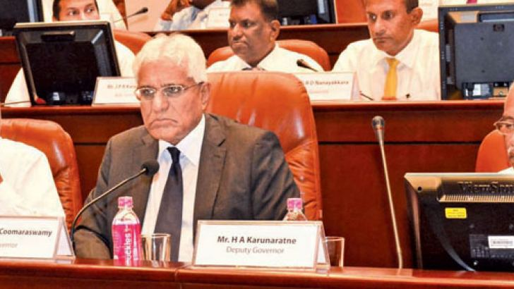 Central Bank Governor Indrajit Coomaraswamy flanked by senior CBSL officials addressing monetary policy meeting yesterday. Picture by Sarath Peiris