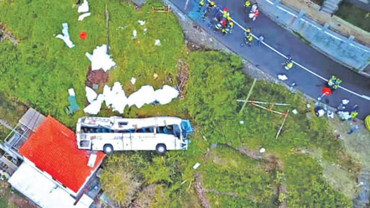 A video grab obtained from drone footage shows the wreckage of a tourist bus that crashed on Wednesday in Canico, on the Portuguese island of Madeira. - AFP