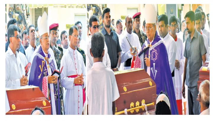 Colombo Archbishop, Cardinal Malcolm Ranjith prays and performs final rites during the funeral service of six victims of the bomb blast on Wednesday.