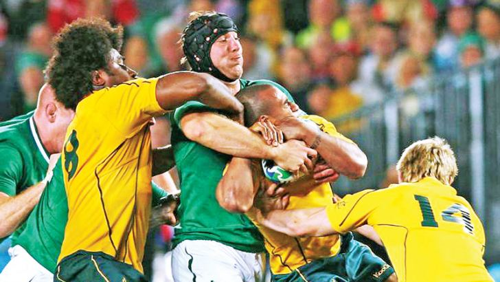 Stephen Ferris tackles Australia's Will Genia at the 2011 World Cup.
