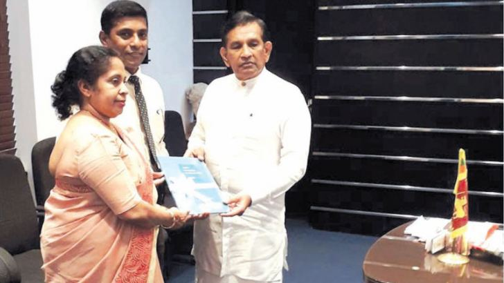 Dr. Chithramalee de Silva and Dr. Kapila Jayaratne handing over the report to Health Minister Dr. Rajitha Senaratne.