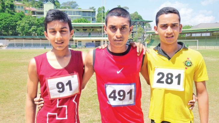 Under 16 Boys 100 Meters winners- First place W.A.Kavindu of Iris House (Middle), second place: I.Yapa Bandara of Ceres House (Left) - third place: Panduka Lochana of Ceres House (Right)