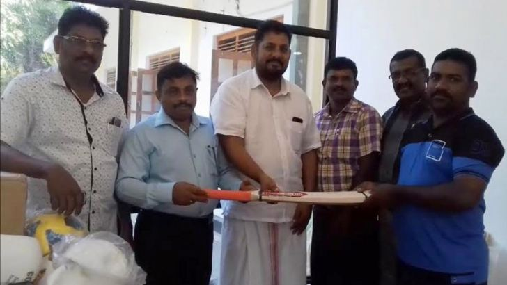 The Kathiravan Sports Club, Thirukkovil officials receiving the sports gear at a ceremony.