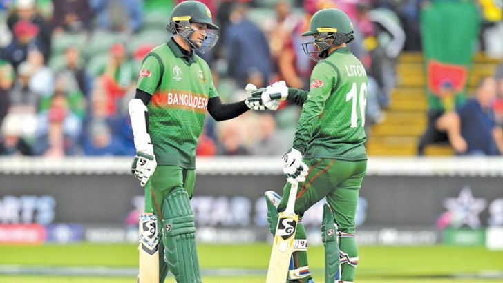 Bangladesh's Shakib Al Hasan (L) celebrates his century with Bangladesh's Liton Das during the 2019 Cricket World Cup group stage match between West Indies and Bangladesh at The County Ground in Taunton, southwest England, on June 17. AFP