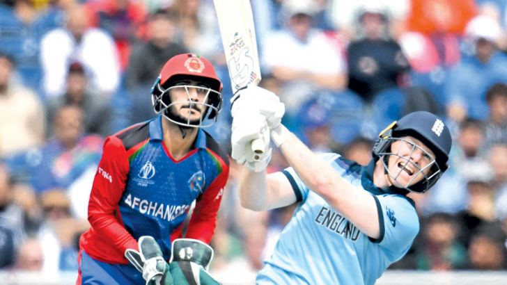 England captain Eoin Morgan hitting one of his world record 17 sixes in the World Cup match against Afghanistan at Old Trafford, Manchester on Tuesday. – AFP