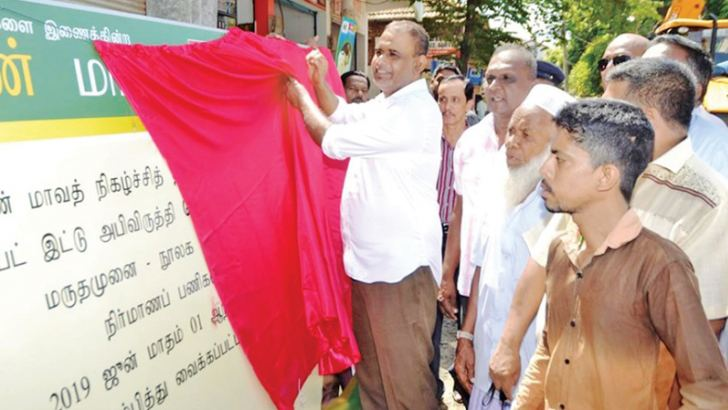 Chief Guest Parliamentarian H.M.M. Harees unveiling the plaque to launch the reconstruction of the road. Picture by I.L.M. Rizan, Addalaichenai Central Corr.