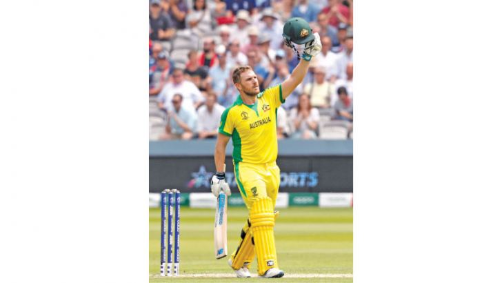 Australian captain Aaron Finch celebrates his century in the World Cup match against England at Lord's on Tuesday.  - AFP