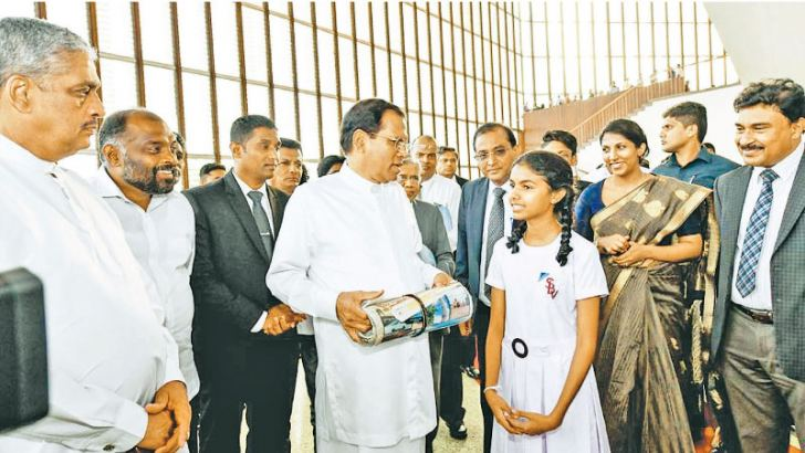 In conversation with President Maithripala Sirisena at the BMICH