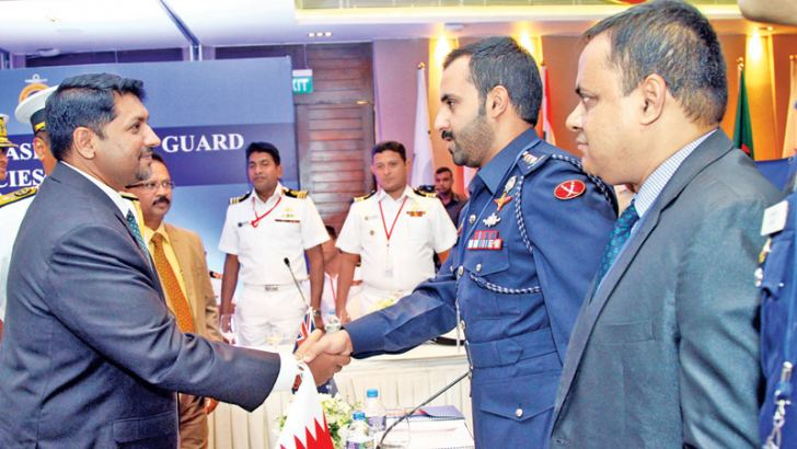 State Defence Minister Ruwan Wijewardene greets a foreign delegate at the inauguration of the 15th Heads of Asian Coast Guard Agencies Meeting (HACGAM) in Colombo yesterday. Picture by Sulochana Gamage