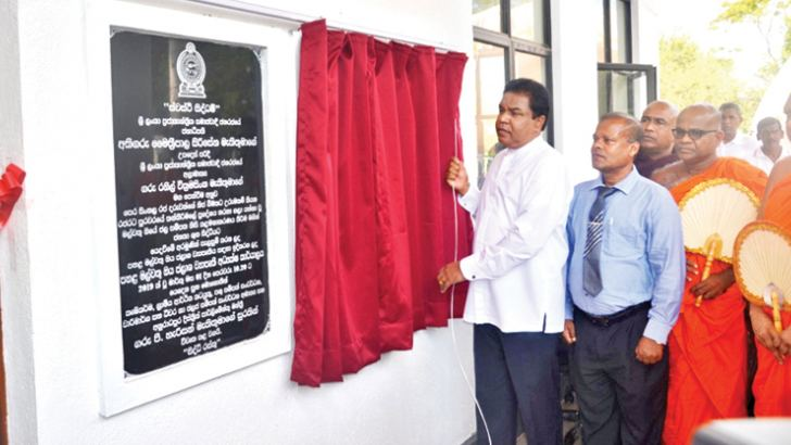 Minister P. Harrison inaugurating the Lower Malwathu Oya Reservoir Project Director's Office Complex while others look on. Picture by Nimal Wijesinghe, Anuradhapura Additional District Group Corr.