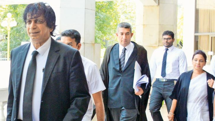 Attorney General Dappula de Livera PC arriving at the Supreme Court flanked by team members Additional Solicitor General Farzana Jameel PC and Deputy Solicitor General Azad Navavi to represent Fundamental Rights petitions filed over the Easter Sunday terrorist attacks. Picture by Sarath Peiris