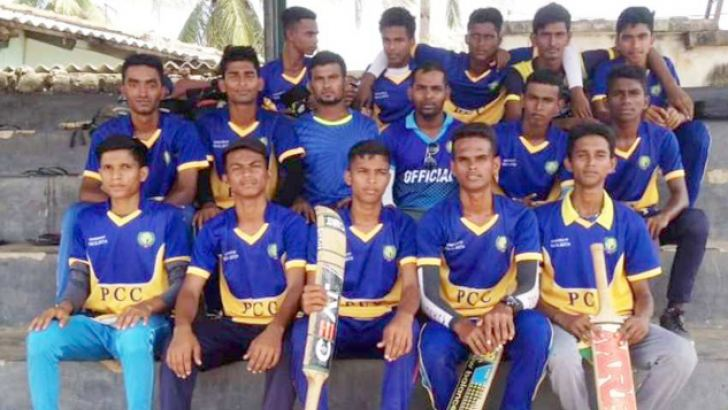 The champion Pottuvil Central College Team with their coach and teacher M.M. Azmi.