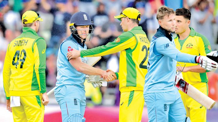 THE VICTOR AND THE VANQUISHED: England captain Eoin Morgan and Joe Root shake hands with the Australian players Steve Smith, Peter Handscomb and Marcus Stoinis after they had won the second World Cup semi-final by eight wickets at Edgbaston on Thursday. - AFP