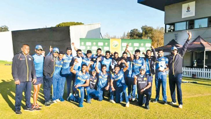 Sri Lankan emerging cricket team poses for a picture after winning the triangular cricket series. Head coach Chaminda Vaas, Dharshana Gamage Assistant coach and Manager and selector on tour Hemantha Wickramaratna are seen here with the team.