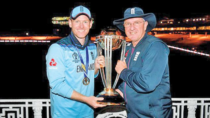 England captain Eoin Morgan and coach Trevor Bayliss share a rare moment with the World Cup.