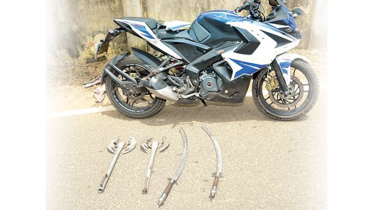 The motorcycle and the swords used by the attackers.