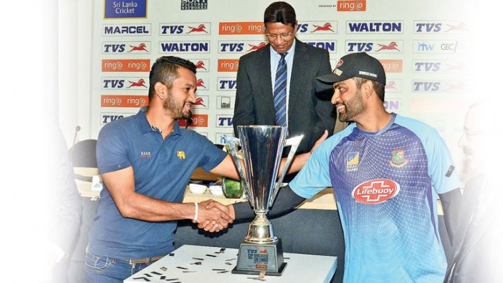 Rival captains Dimuth Karunaratne (Sri Lanka) and Tamim Iqbal (Bangladesh) shake hands at the media conference held at Taj Hotel yesterday. The two teams will play the 3-match ODI series for the TVS Cup. Picture by Wimal Karunathilake