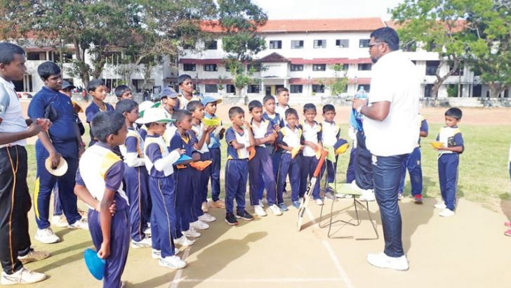 K G Priyantha with the young talent of the Rahula College Cricket Academy in Matara.