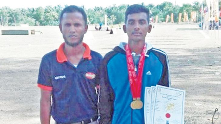 A.C.Abdullah with his coach