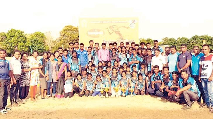 Victorious athletes of Kaluthavalai National School with their throphies. Picture by Sivam Packiyanathan, Batticaloa Special Corr.