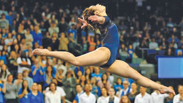 Ohashi competes in floor exercise during a meet at Pauley Pavilion in Los Angeles, California.