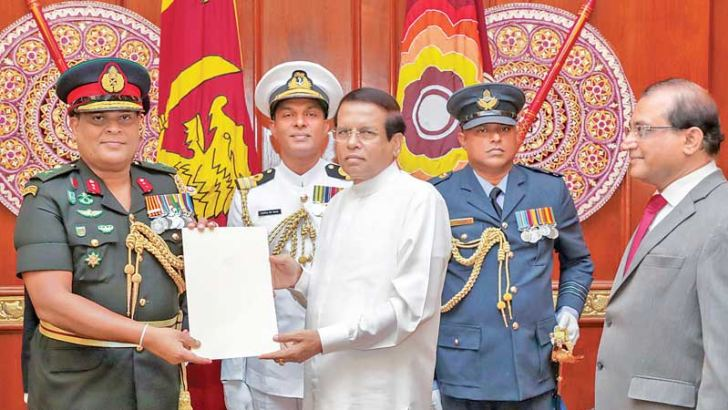 Lt. General Shavendra Silva received the appointment letter as the 23rd Commander of the Sri Lanka Army from President Maithripala Sirisena yesterday. Secretary to the President Udaya R. Seneviratne and Secretary to the Ministry of Defence Major Gen. Shantha Kottegoda were also present. Picture by Sudath Silva (President's Media Division)