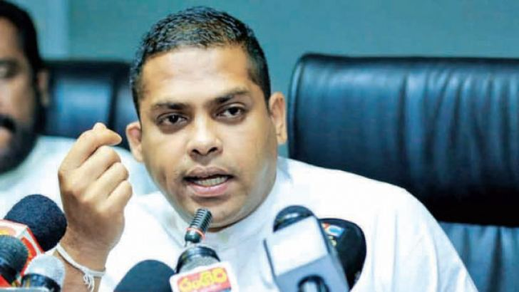 Sports Minister Harin Fernando addressing a press conference yesterday.