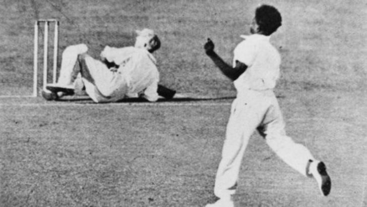 Don Bradman hits the turf after a searing bouncer from Gilbert.