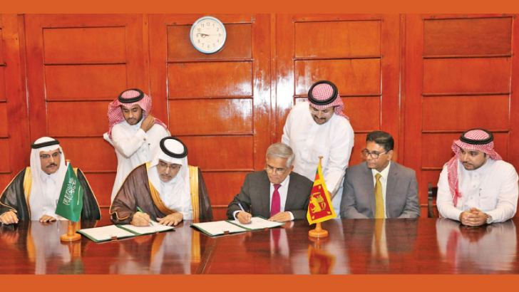 Finance Ministry Secretary Dr. R.H.S. Samaratunge and Dr. Khaled Sulaiman Alkhudairy, Vice Chairman and Managing Director on behalf of the Saudi Fund,  signing the loan agreement.