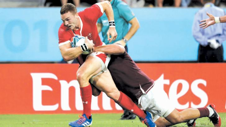 Wing George North scored Wales' final try.  - AFP