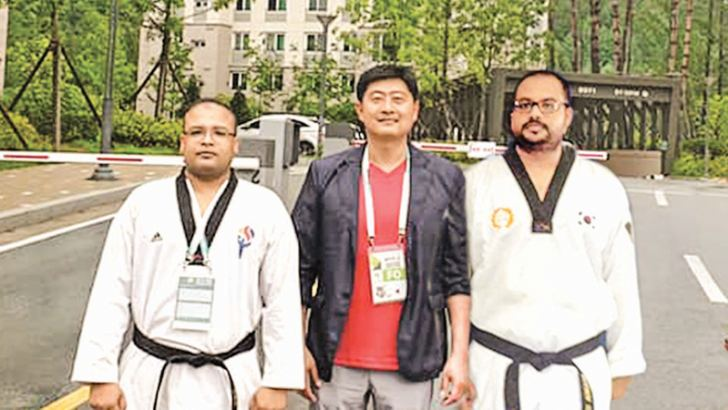 Asanga and Asitha are seen here with a competitor from South Korea.
