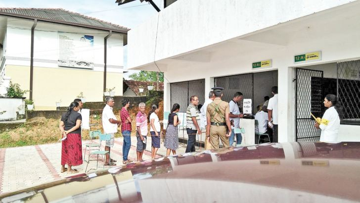 More than 53,000 people were eligible to cast their  votes at the Elpitiya Pradeshiya Sabha election which was held yesterday. Elections officials confirmed that voter turnout exceeded 79 per cent when voting ended  yesterday evening. The voters at a polling station.  Picture by Lankinda Nanayakkara, Imaduwa Group Corr.