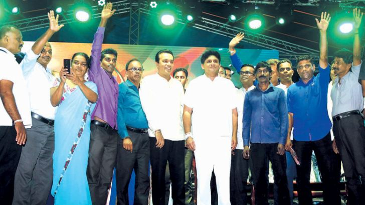 Some of the 16 SLFP representatives of the Ratnapura district who attended the Pelmadulla rally yesterday with UNF Presidential Candidate Sajith Premadasa on stage. Picture by Hirantha Gunathileke