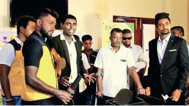 Brand Ambassador for E9PAY Thought Leader, Venura Perera, E9PAY Manager Promotions Indunil Samayamanthri and officials from E9PAY presetting equipment in Colombo last week
