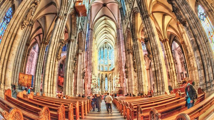 The richly carved ornate interior of the magnificent Cathedral in Cologne is a testimony dedicated to Lord Jesus.
