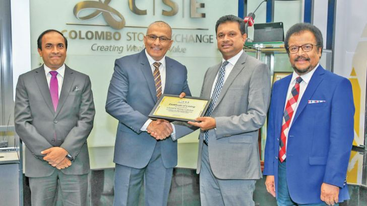 CSE Chairman Ray Abeywardena presents Listing certificate to LAUGFS Power Limited Chairman W.K.H. Wegapitiya